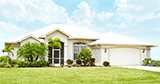 Florida Stucco Style Home with Metal Roofing