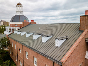 Standing seam metal roof on brick building